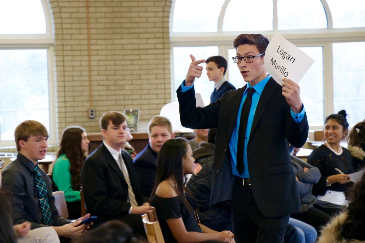 Logan, a junior gives his speech and campaigns during mock election
