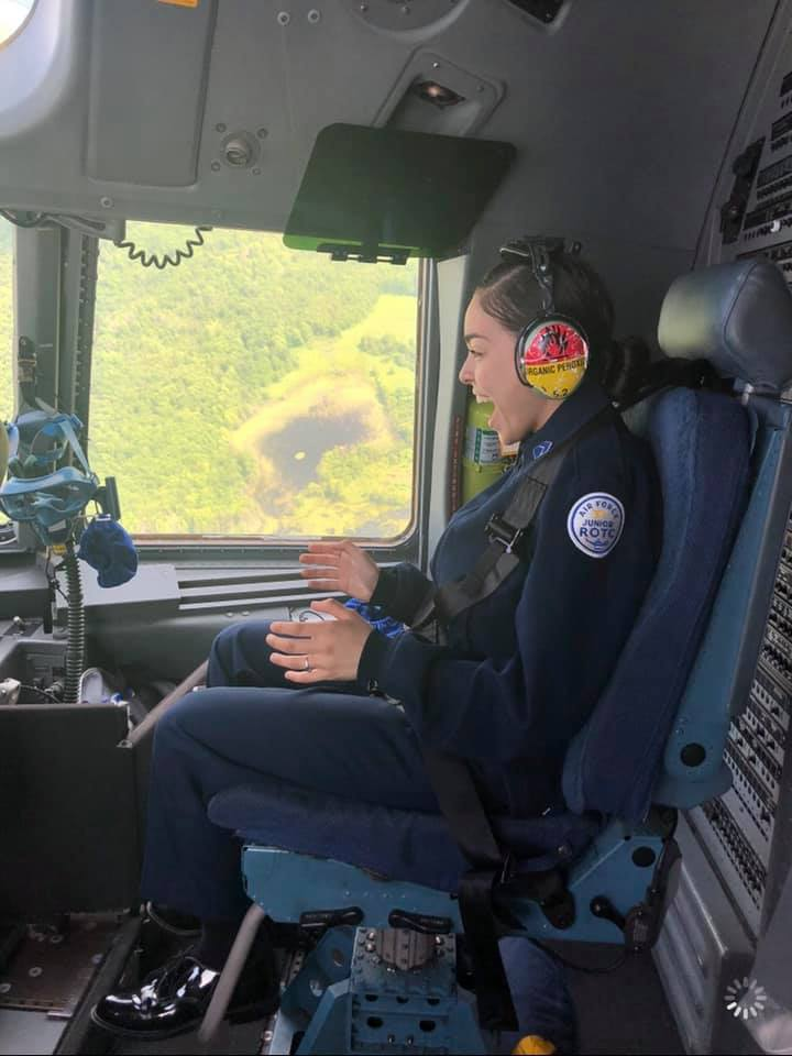 Student sitting in cockpit.