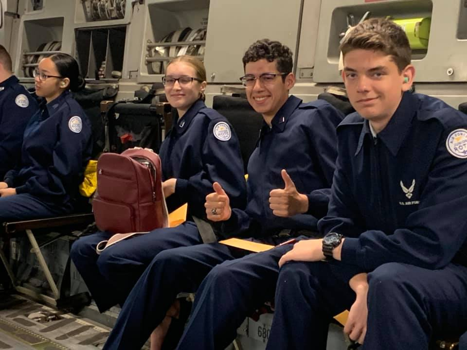 Students sit together on flight.