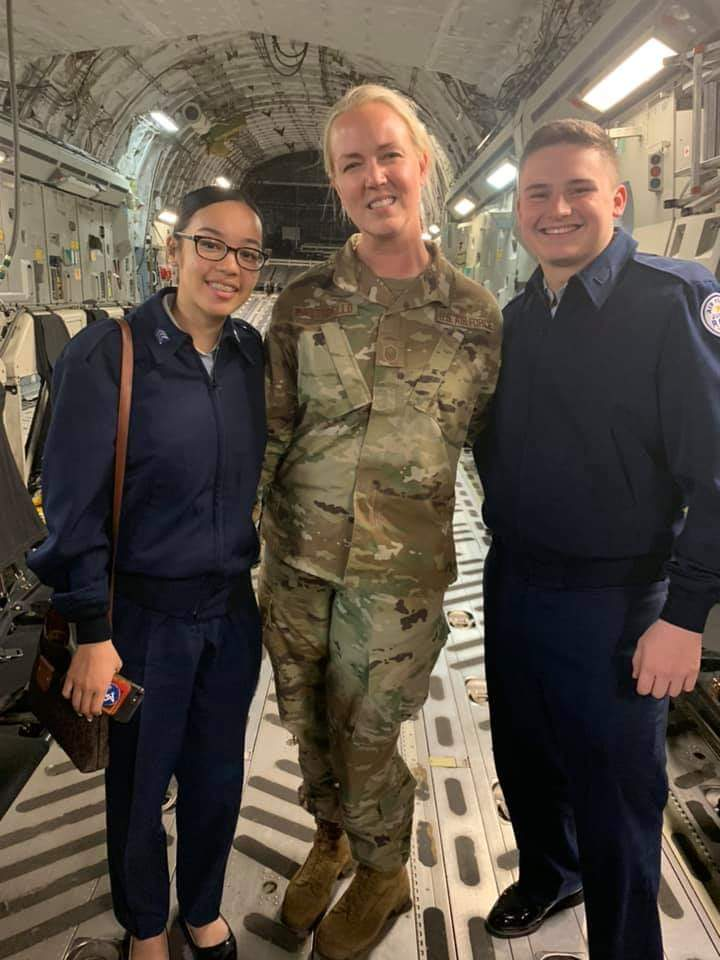 Students stand for photo with MSgt Sara Ruggiero Pastorello.