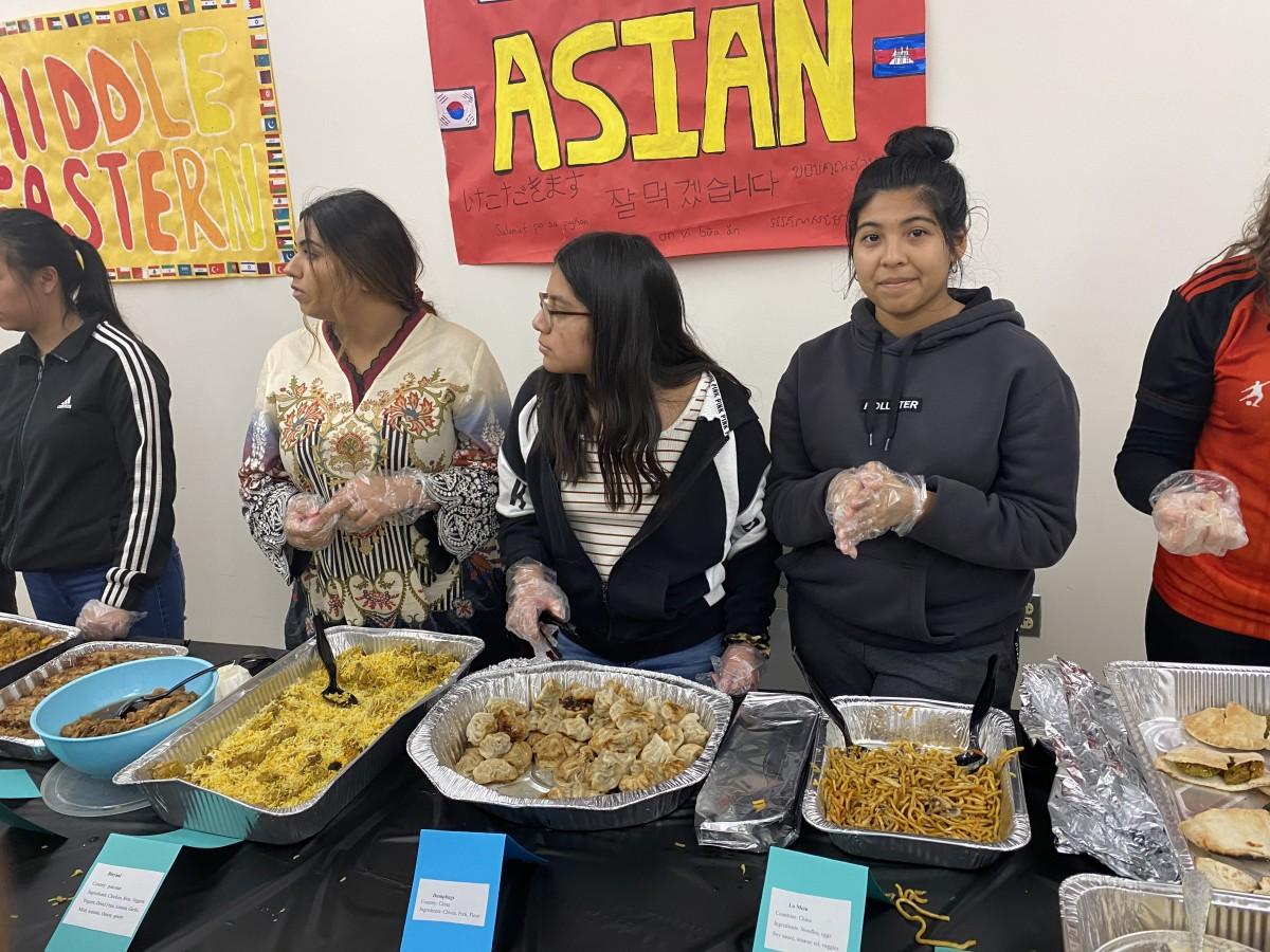 NFA Key Club members serve food to their guest.