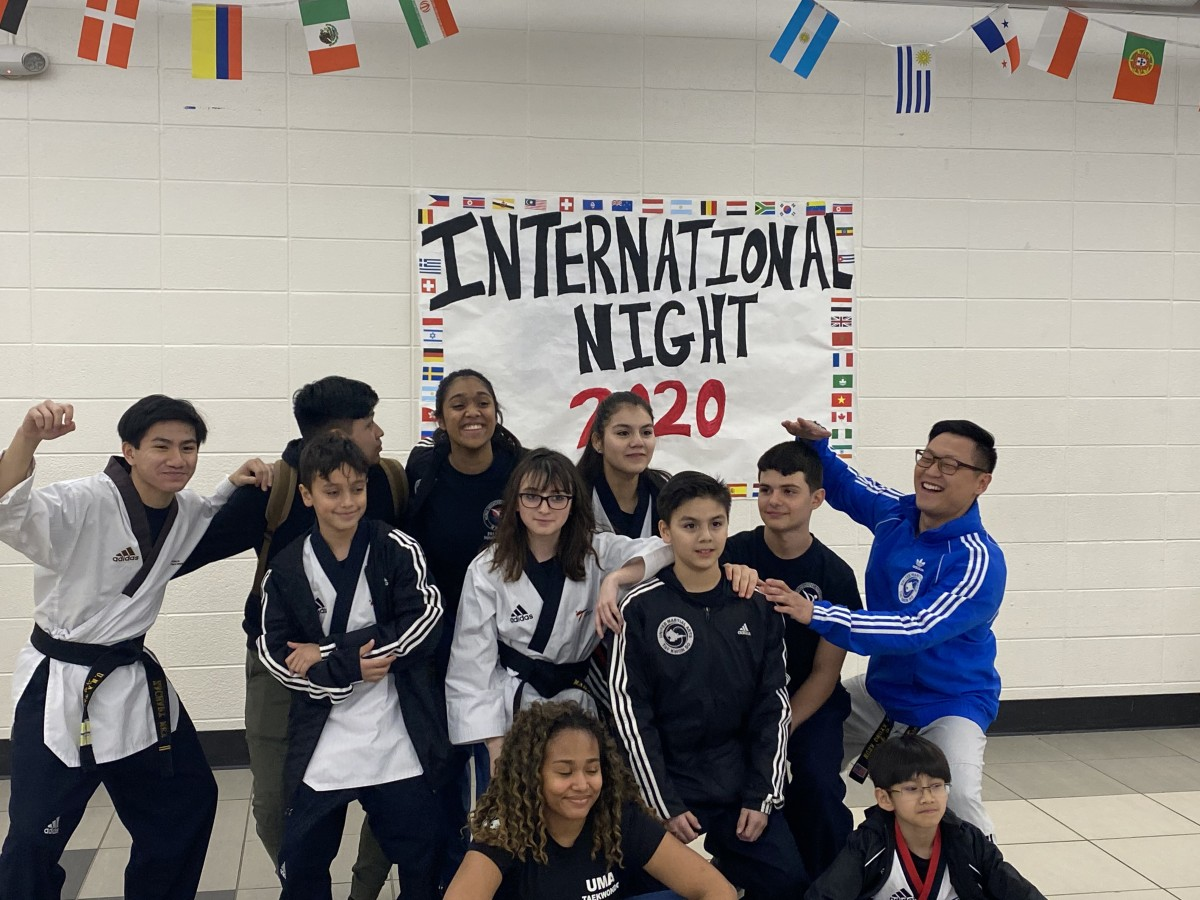NFA Key Club members and performers pose for a photo.