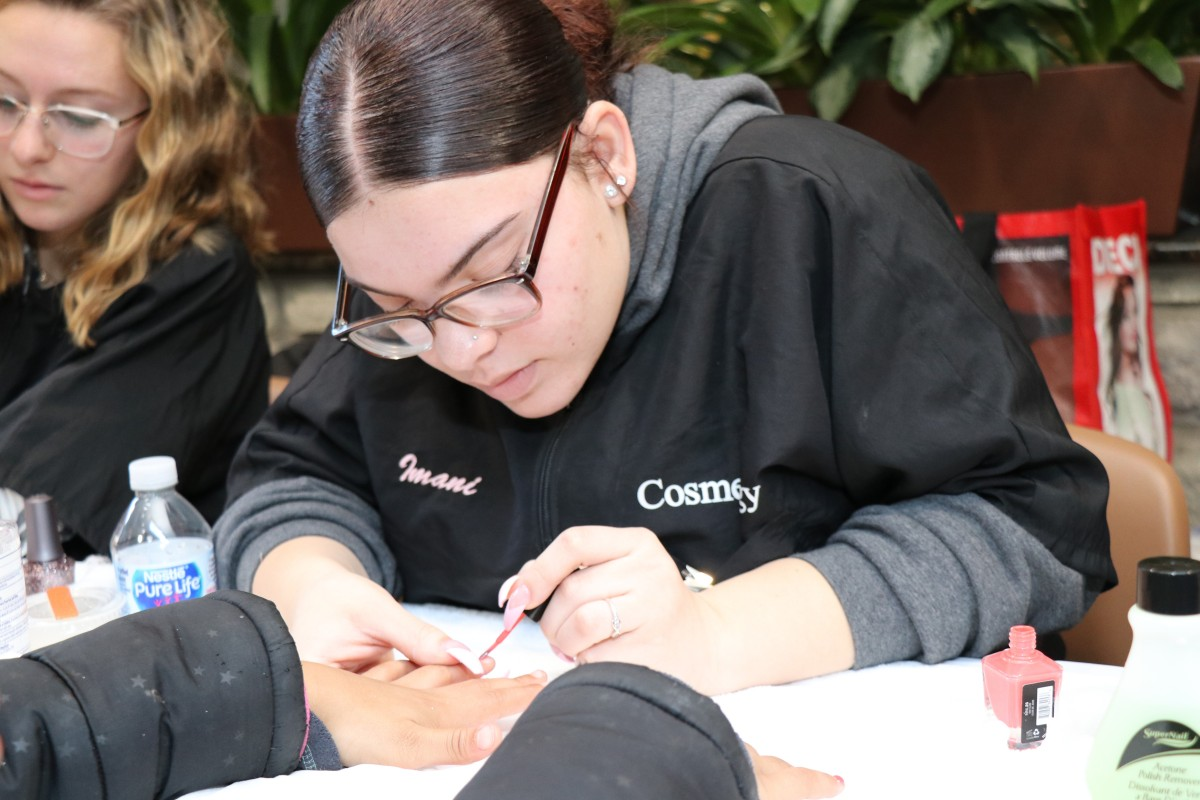Student painting nails.