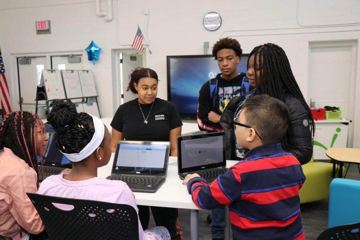High school scholars teaching elementary scholars.