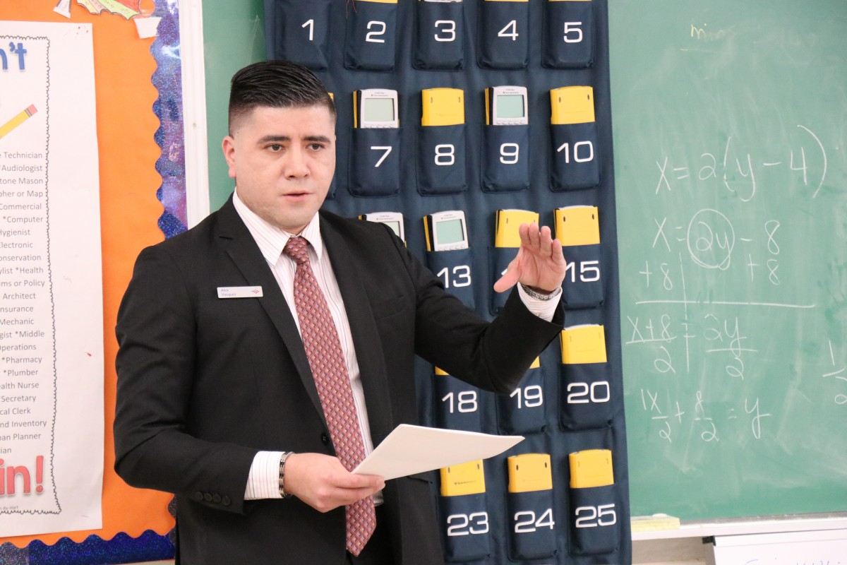 Representative speaks to the class.