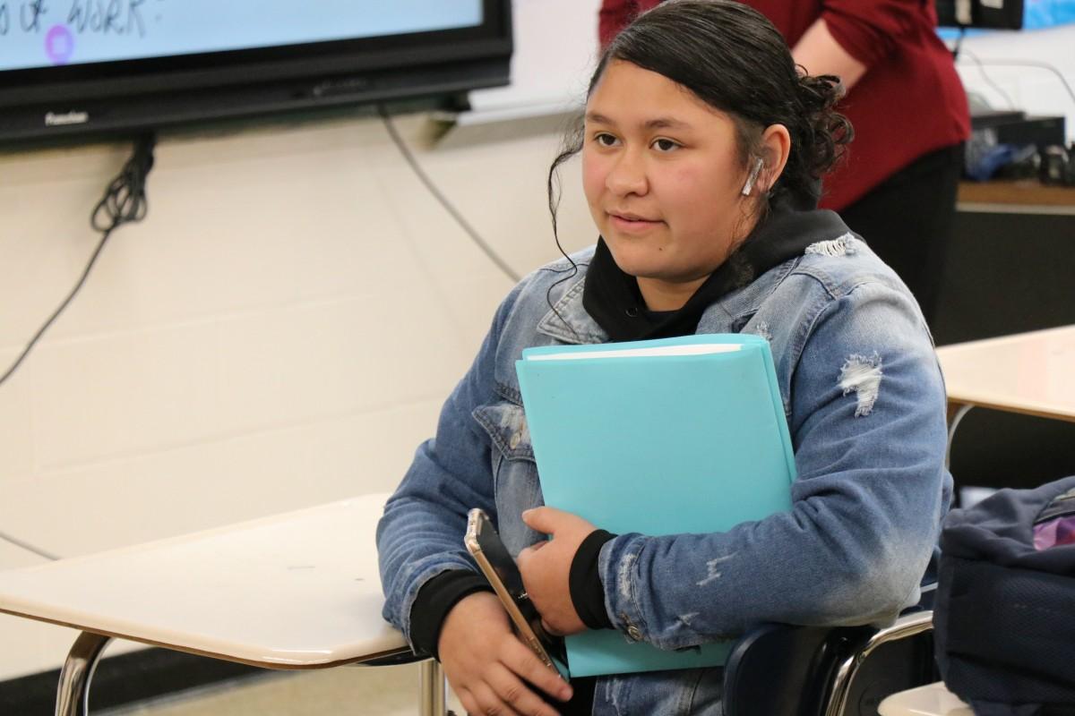 Student listening to presentation.