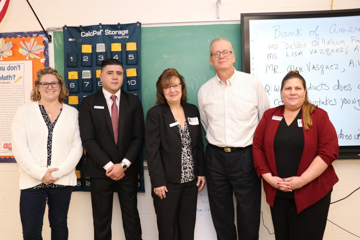 Representatives and teachers pose for a photo.