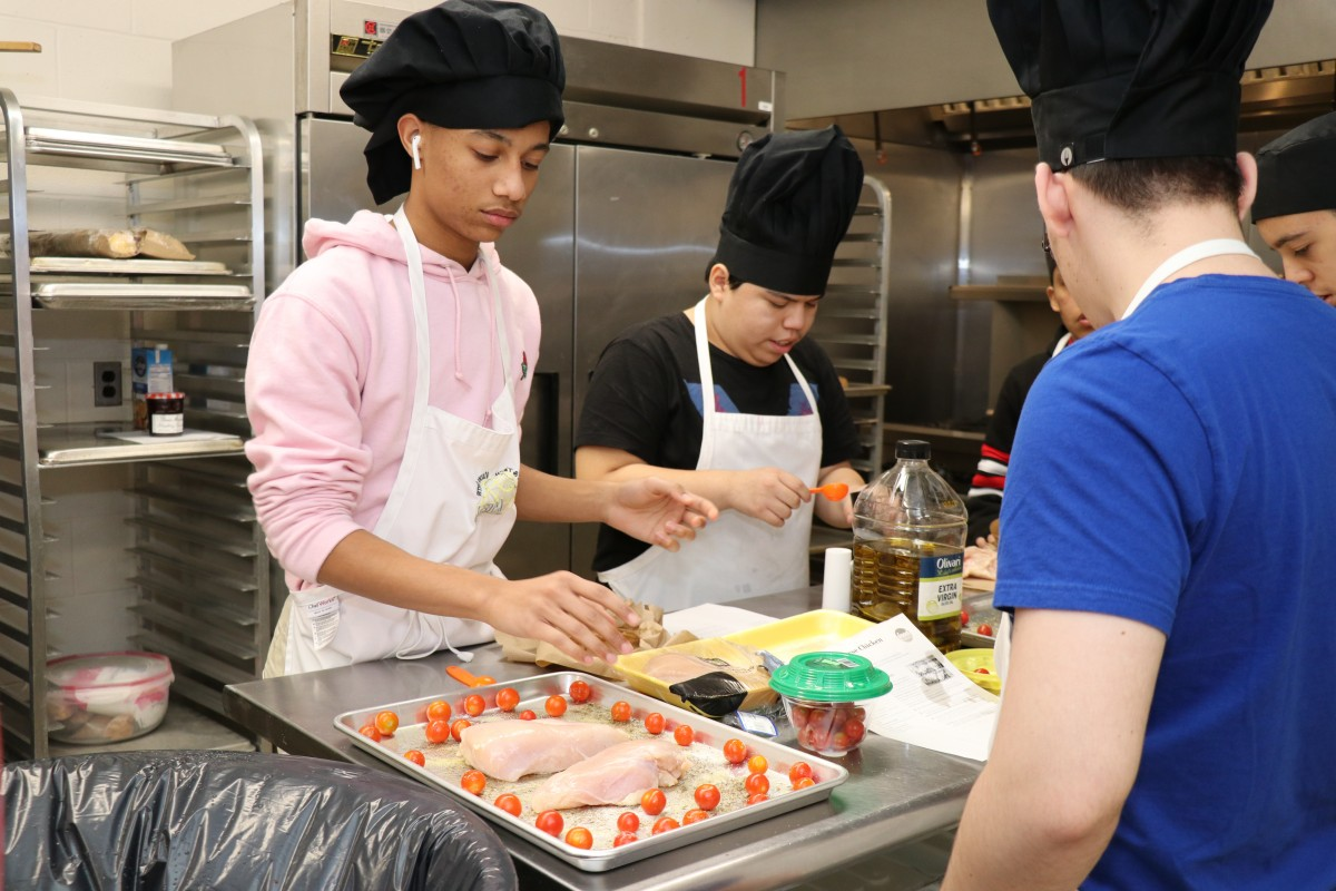 Students preparing a meal.