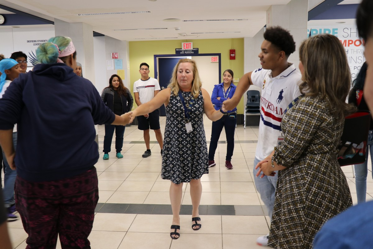 House principal, Ms. Sandy Wood engages students in an activity.