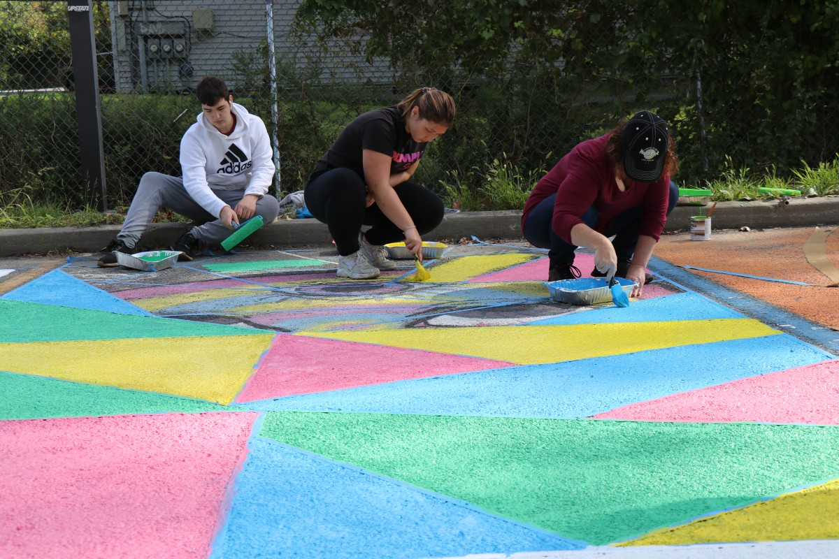Students painting parking spot.