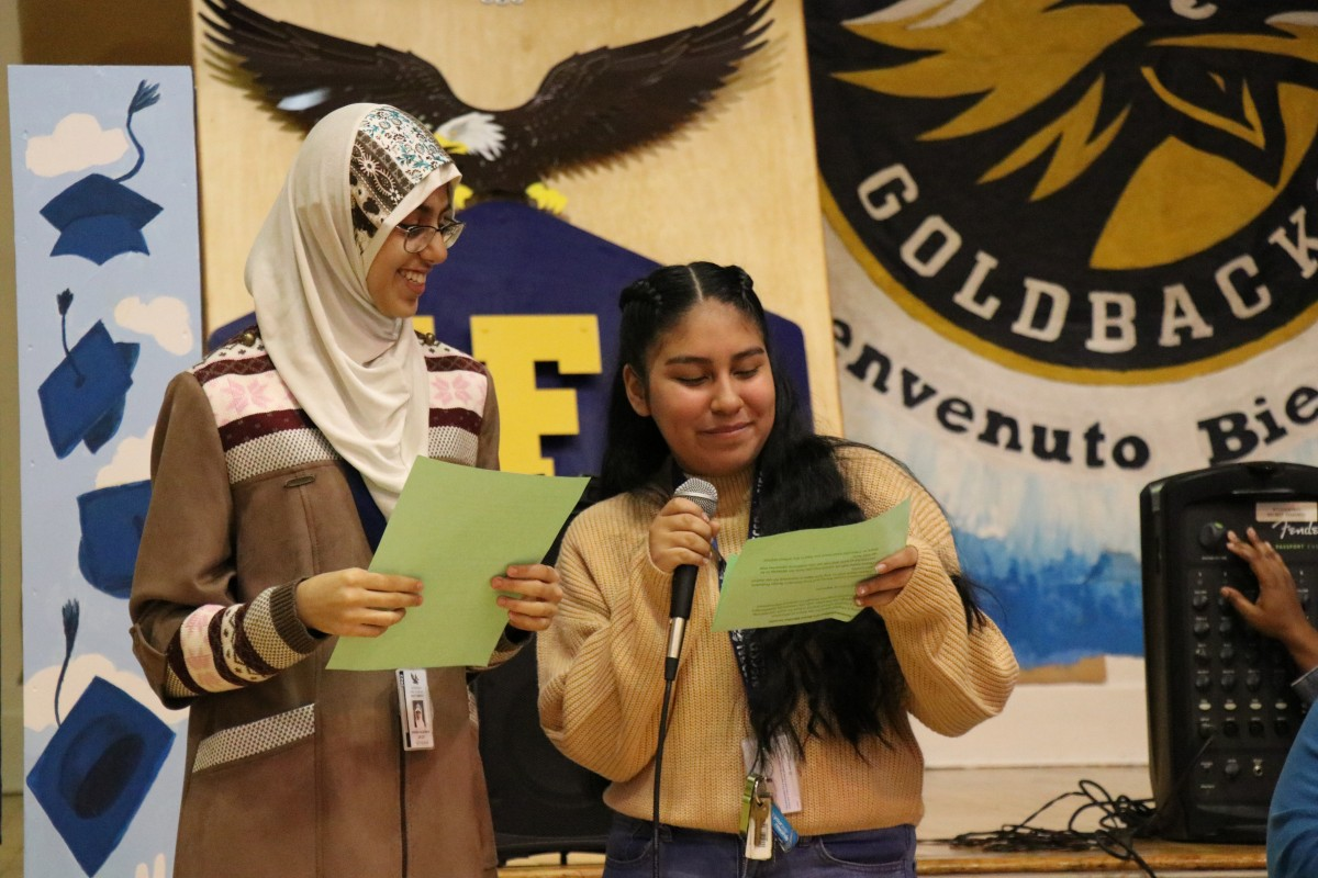 Aishah Alshaikh and Melanie Rodriguez, both 9th grade scholars at NFA West, introduce the panelists.