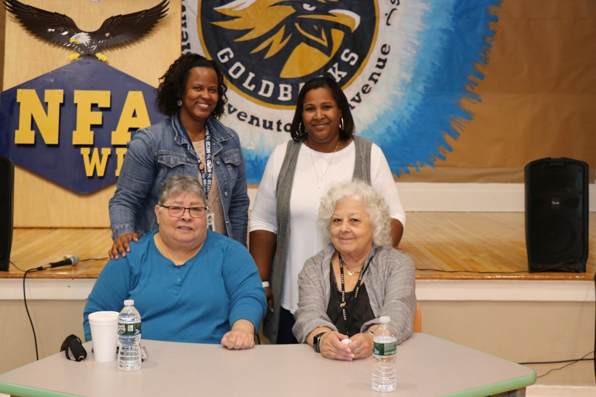 Co-principal Ms. Clark, guidance counselor Ms. Stukes, Ms. Prokosch, and Ms. Mineo pose for a photo.