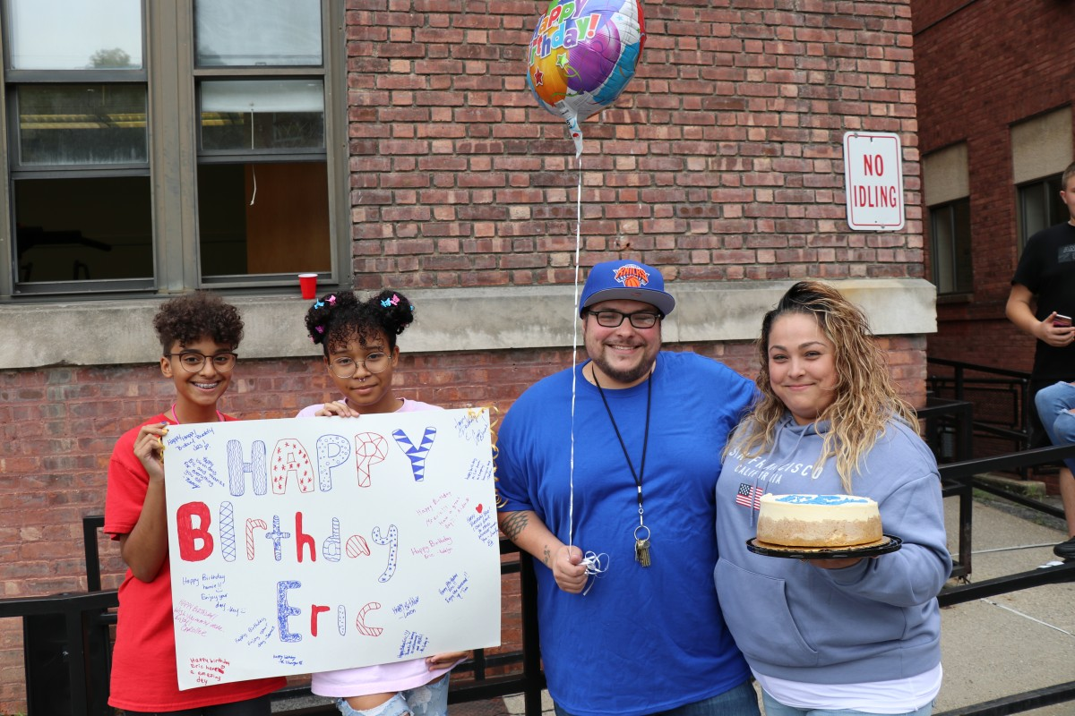 Students celebrate custodian's birthday.