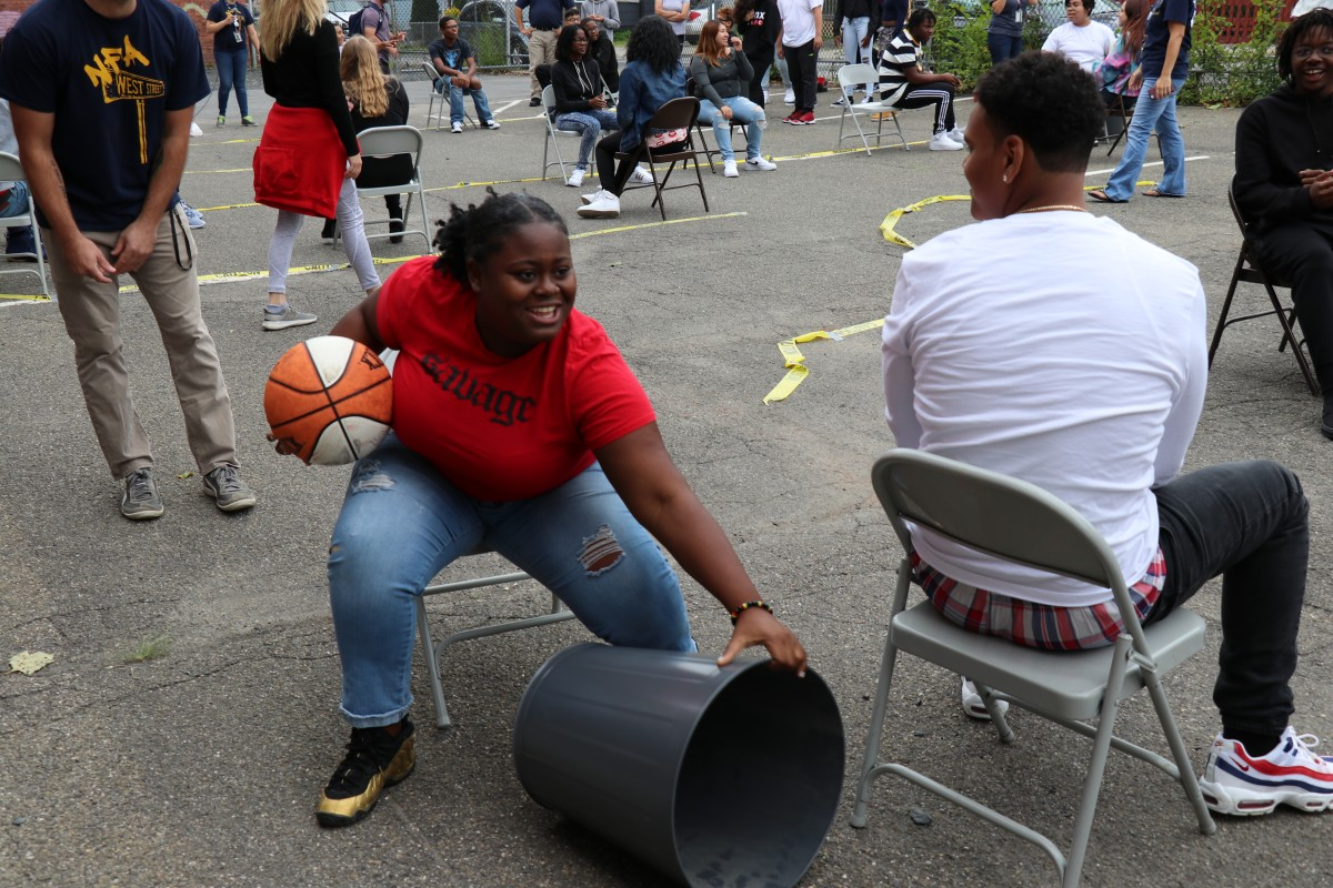 Students play seated basketball game.