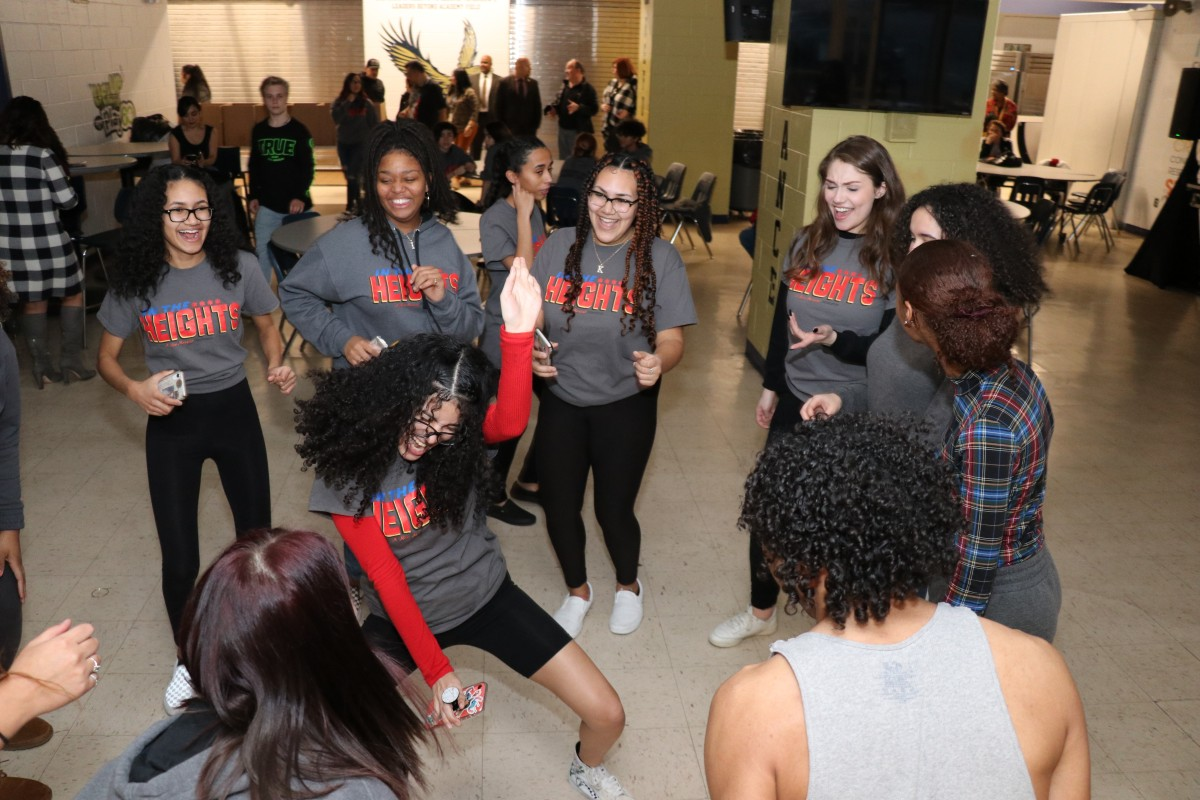 Students dancing in a group.