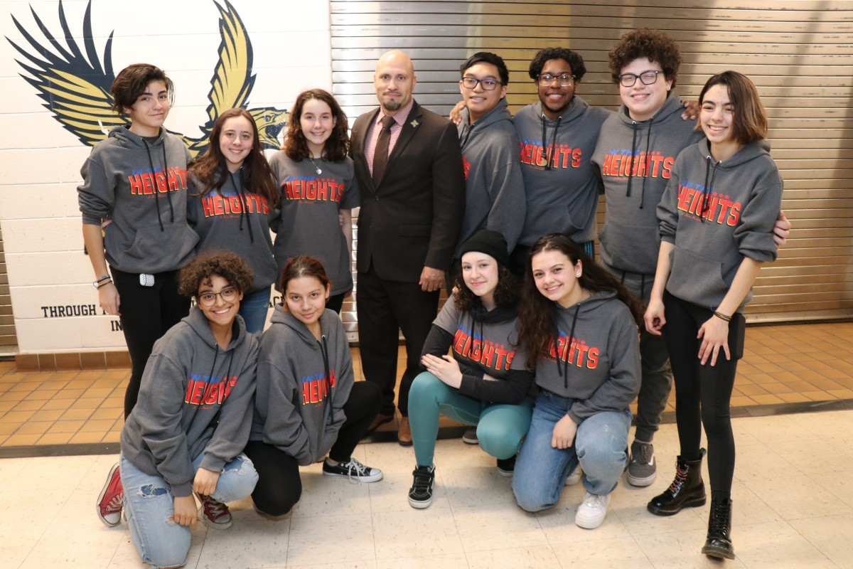Cast and crew members of In the Heights pose for a photo with Superintendent Dr. Padilla.