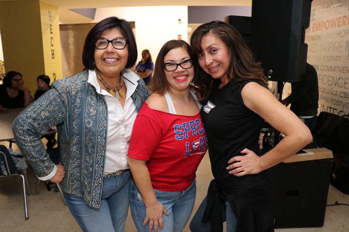 Salsa instructions, Maritza Calderon-Caballero and Kattya Fernandez pose for a photo.