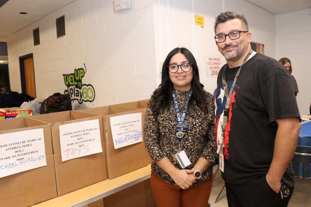 Ms. Laura Garcia and Mr. Roberto Cruz pose for a photo.