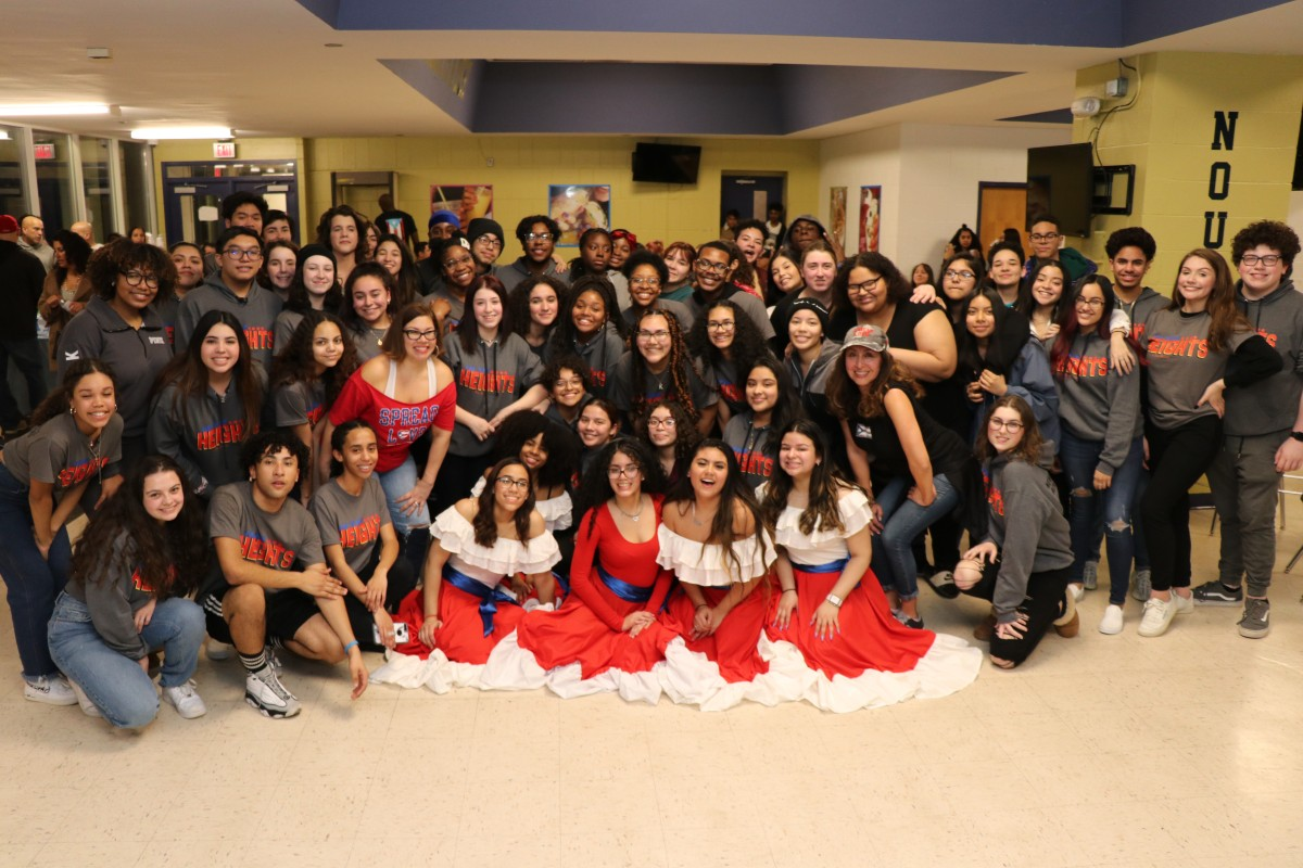 Cast and crew of In the Heights pose for a photo.