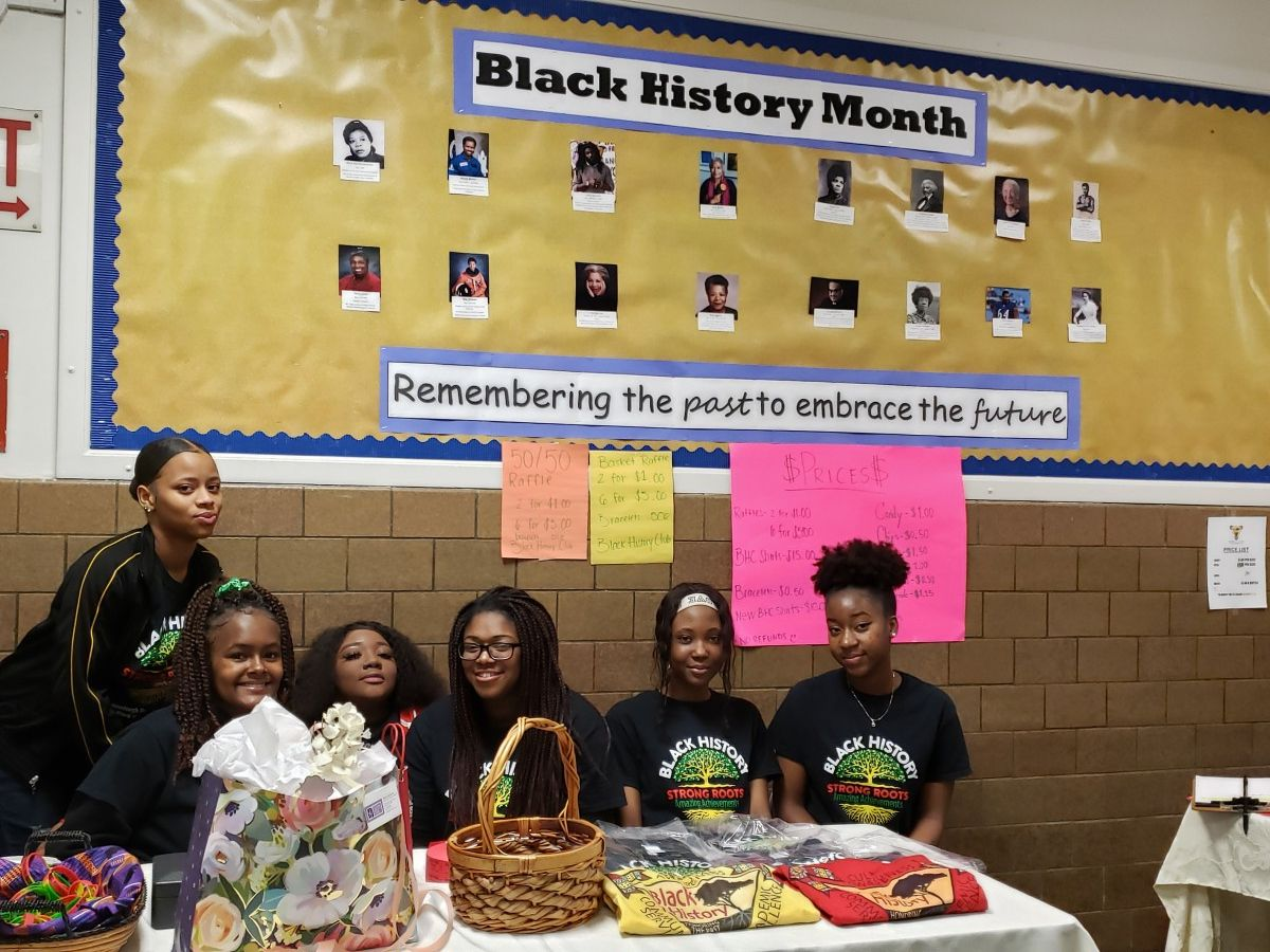 Members of the NFA Black History Club pose for a photo at the check-in table.
