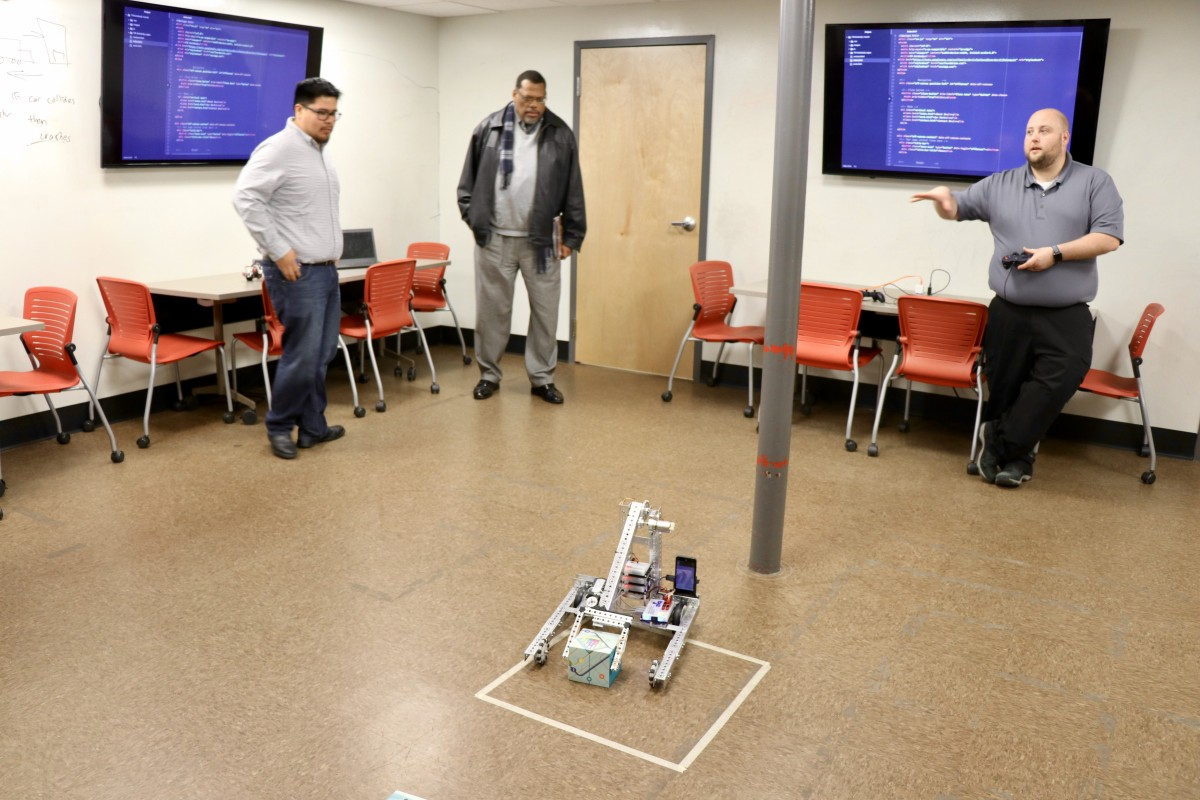 Mr. Svarczkopf shows off robot made by students