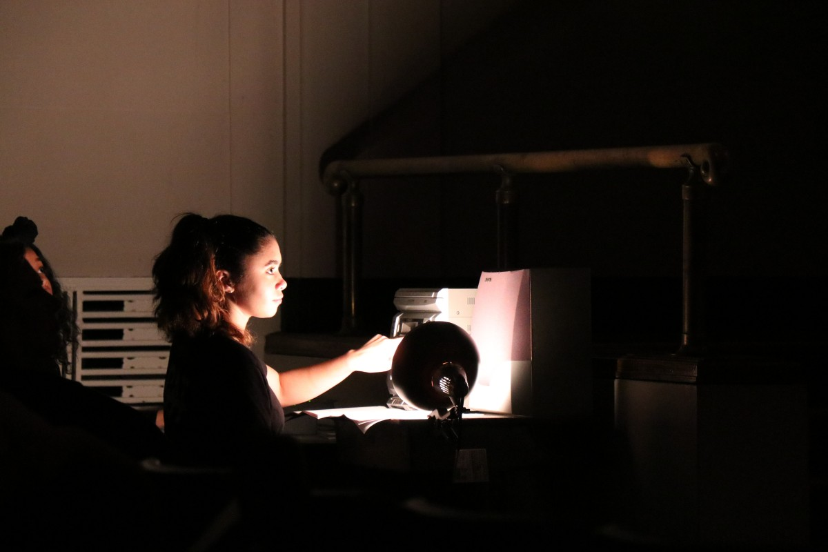 Student adjusts lighting for the performance