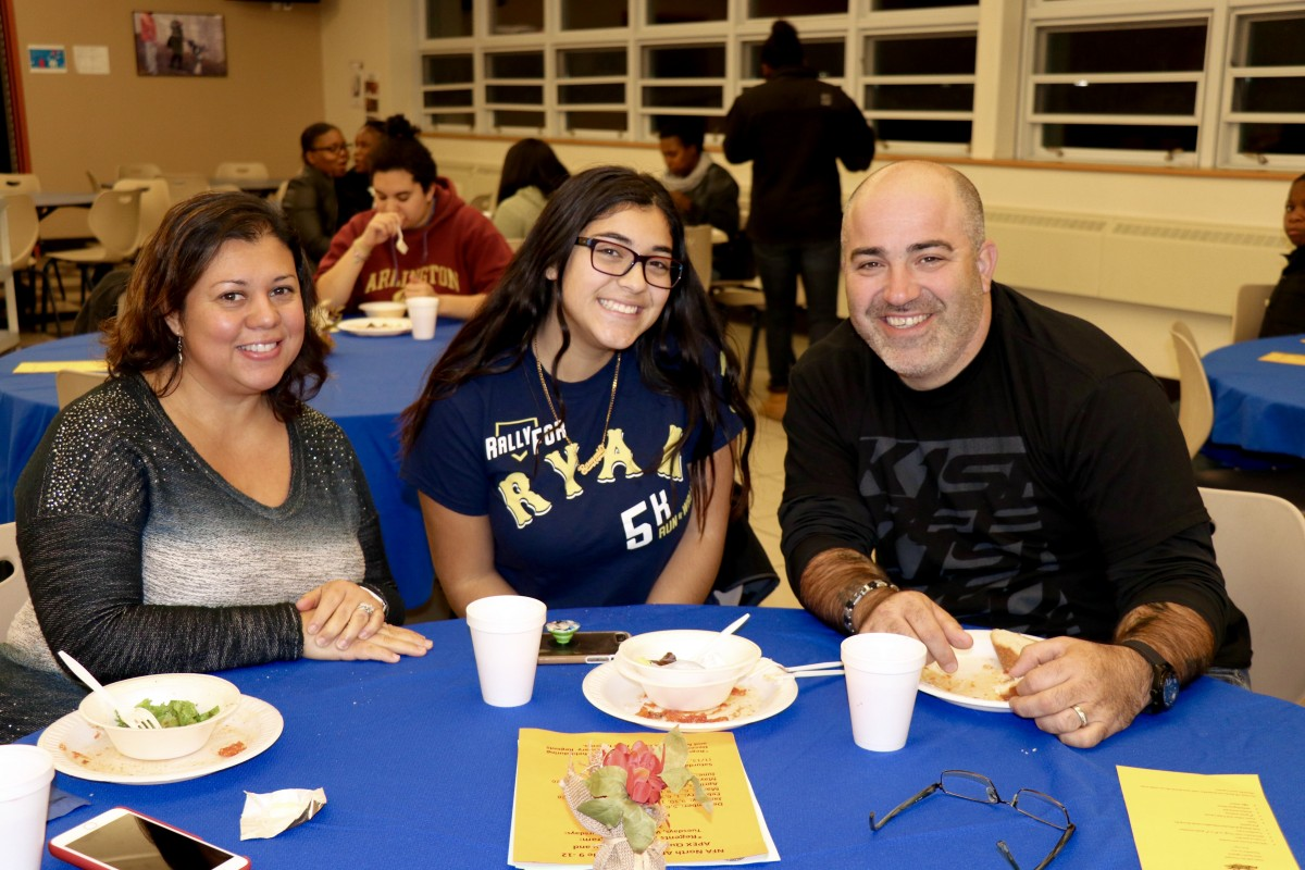 Family enjoys Pasta with the Principal