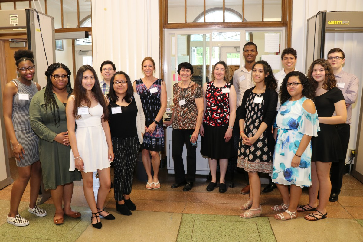 Student presenters, keynote speaker, and advisors pose for a group photo.