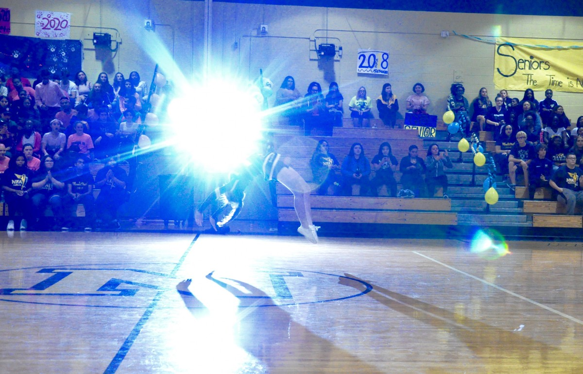 A cheerleader tumbles at the Pep Rally