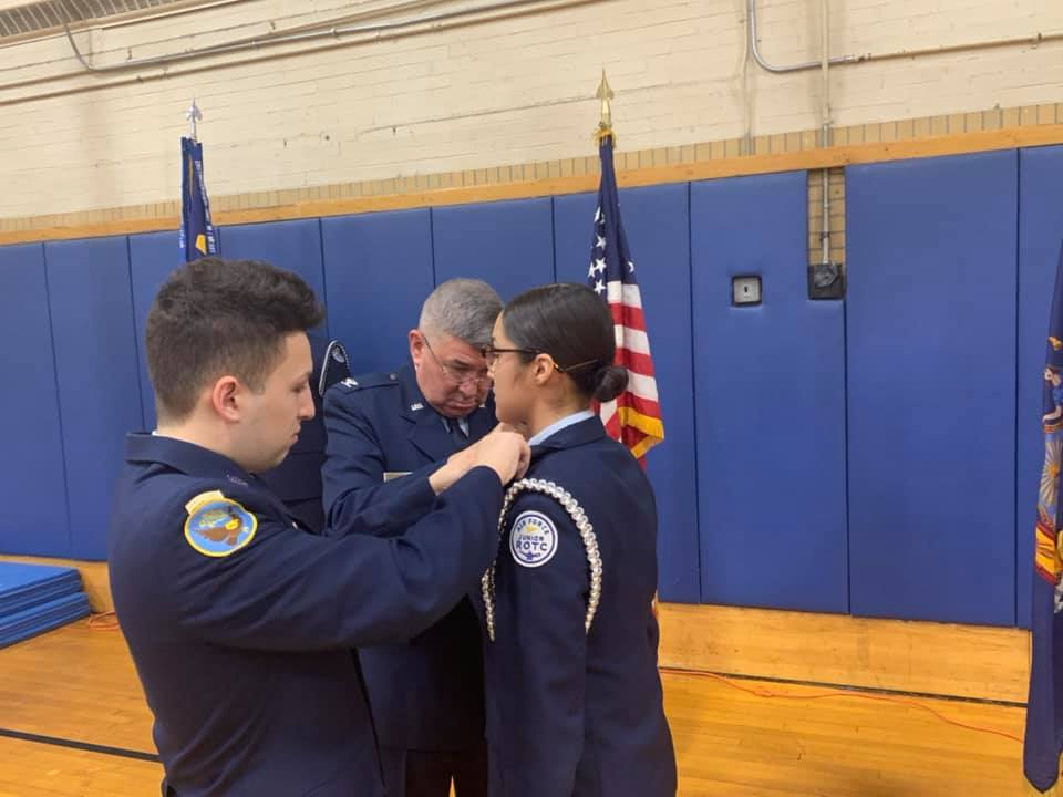 Student receiving updated pins.