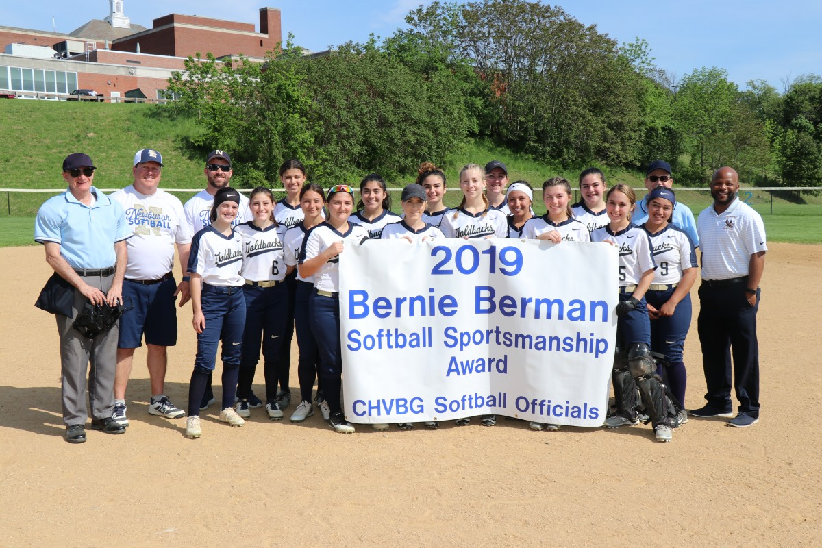 Team with award banner.