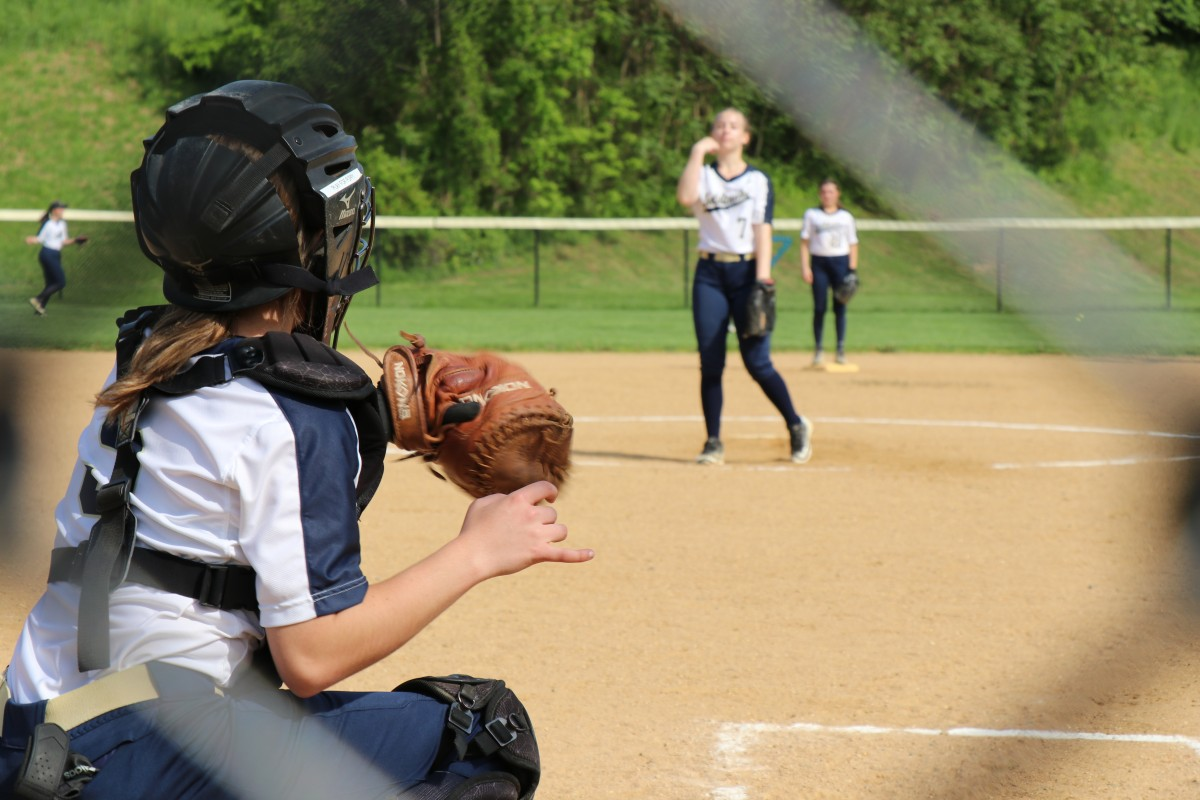 NFA player pitching ball.