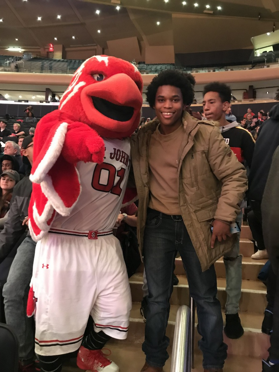 Student poses with mascot