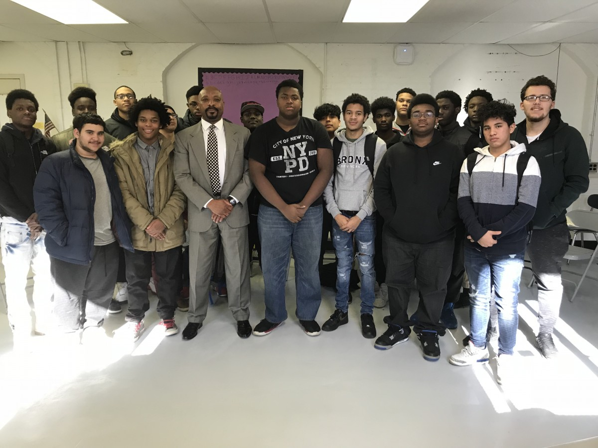 All Male Mentoring Group students pose with Mr. Newton