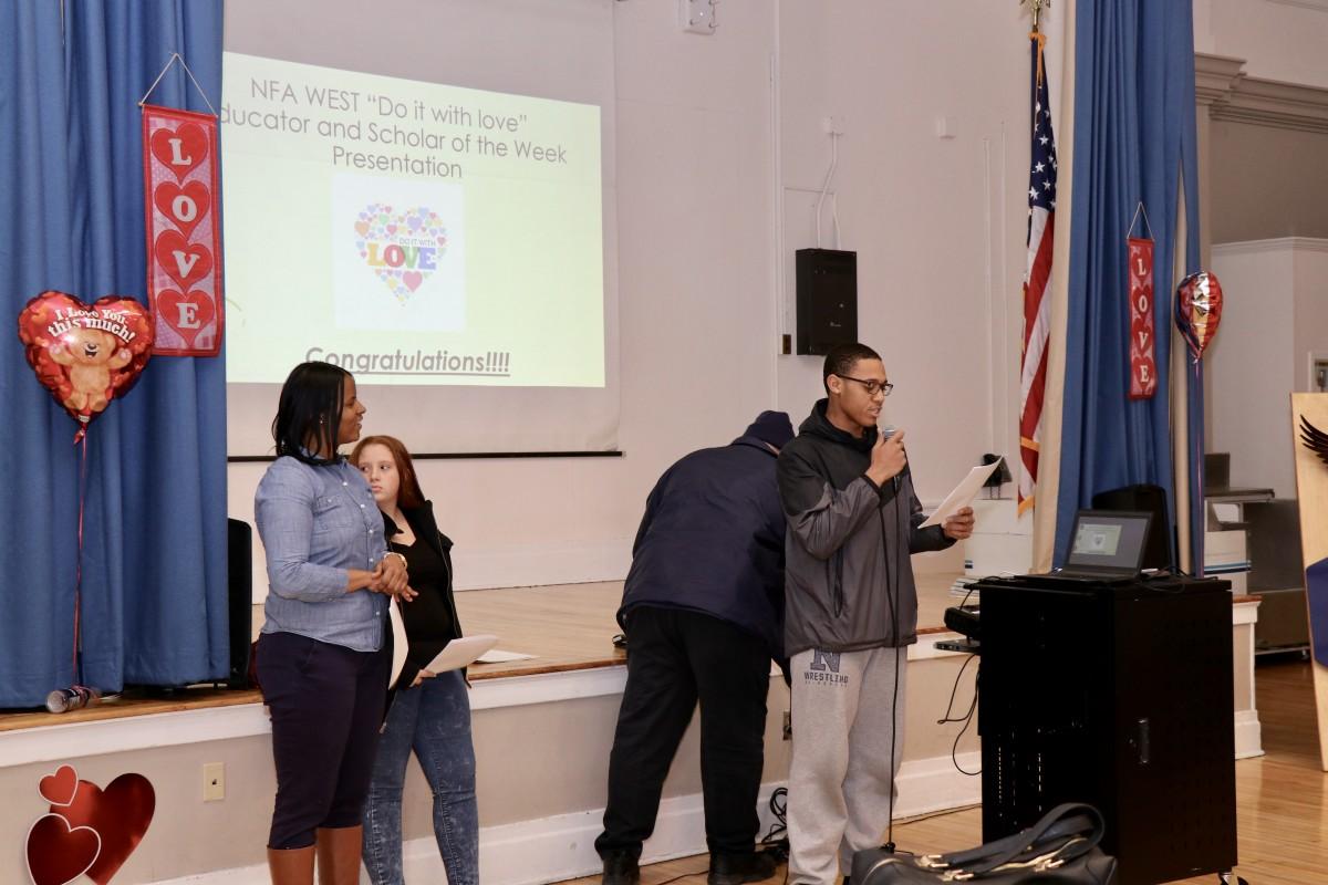 Student, Darius announcing the award