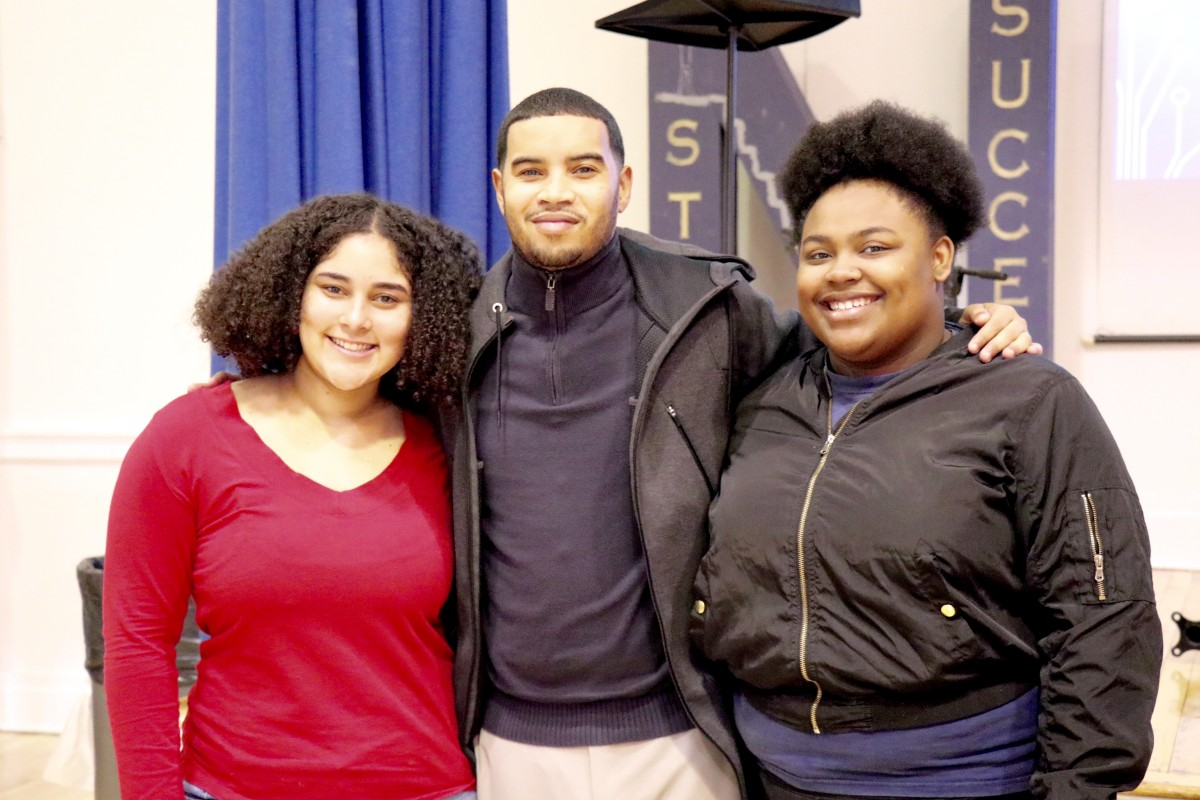 Panelist poses with students
