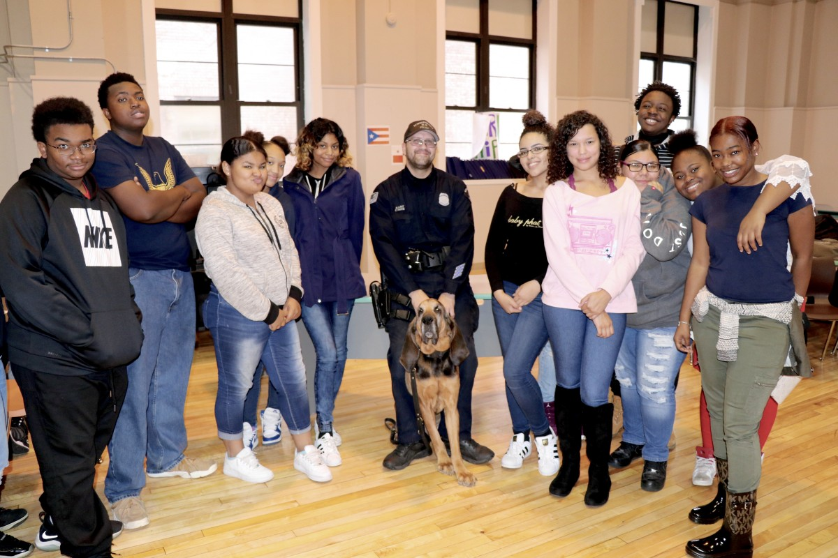 Students poses with office and K9