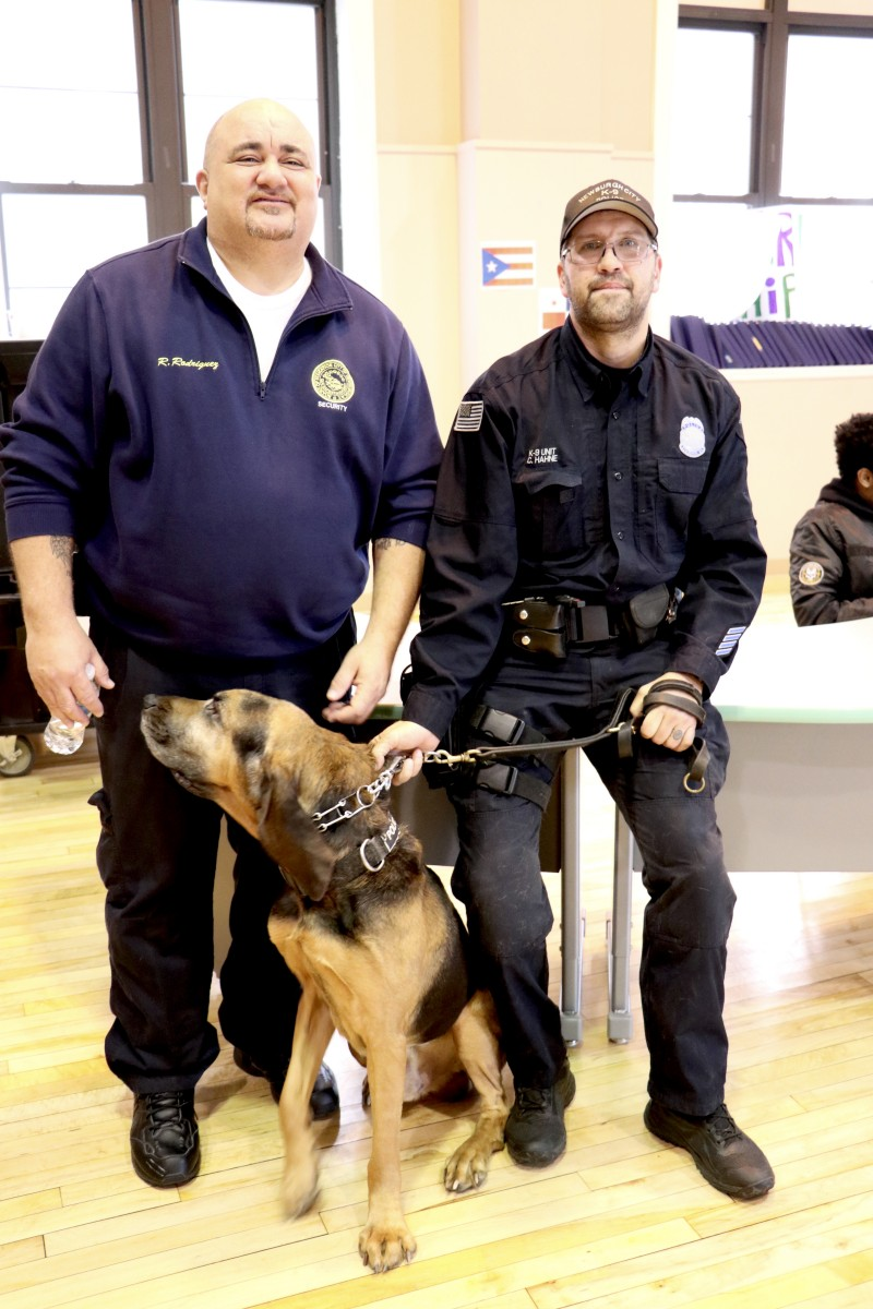 Mr. Rudy Rodriguez poses with office and K9