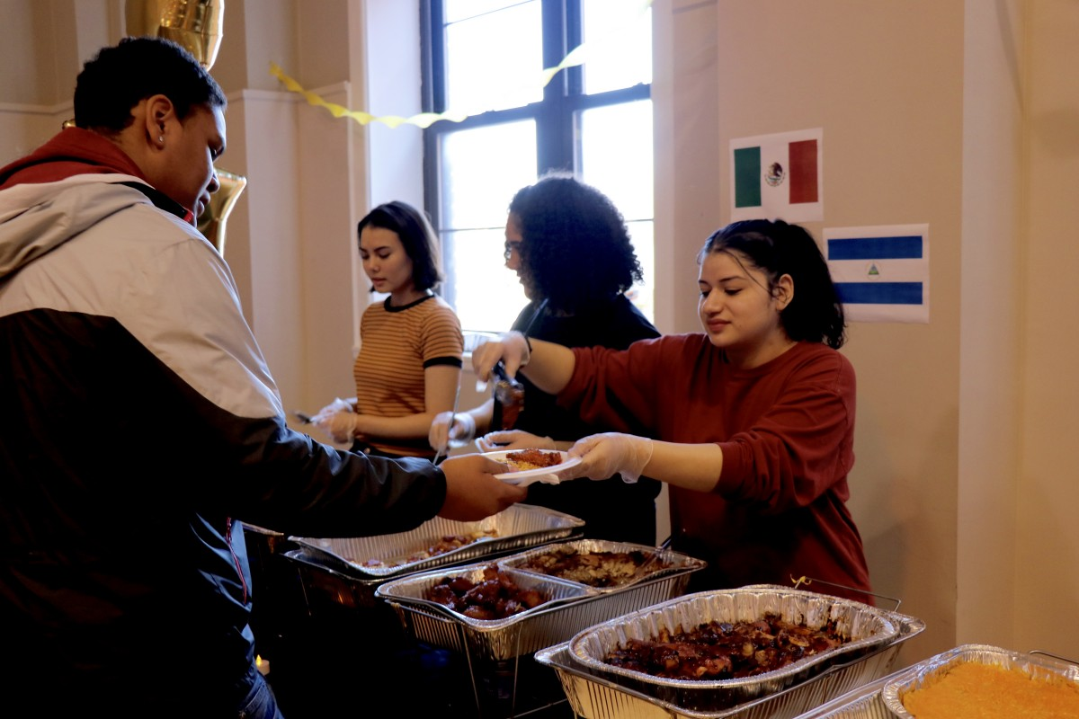 Students serve each other for International Celebration