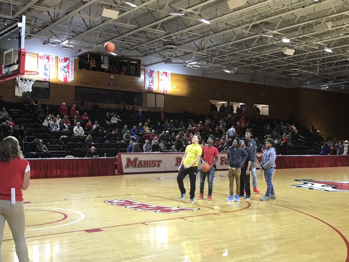 Students play game on court at halftime