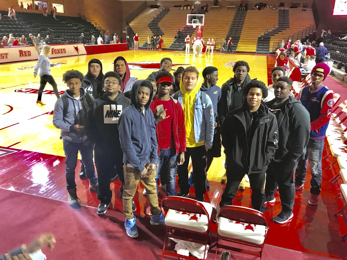 NFA West students pose on floor of Marist basketball court