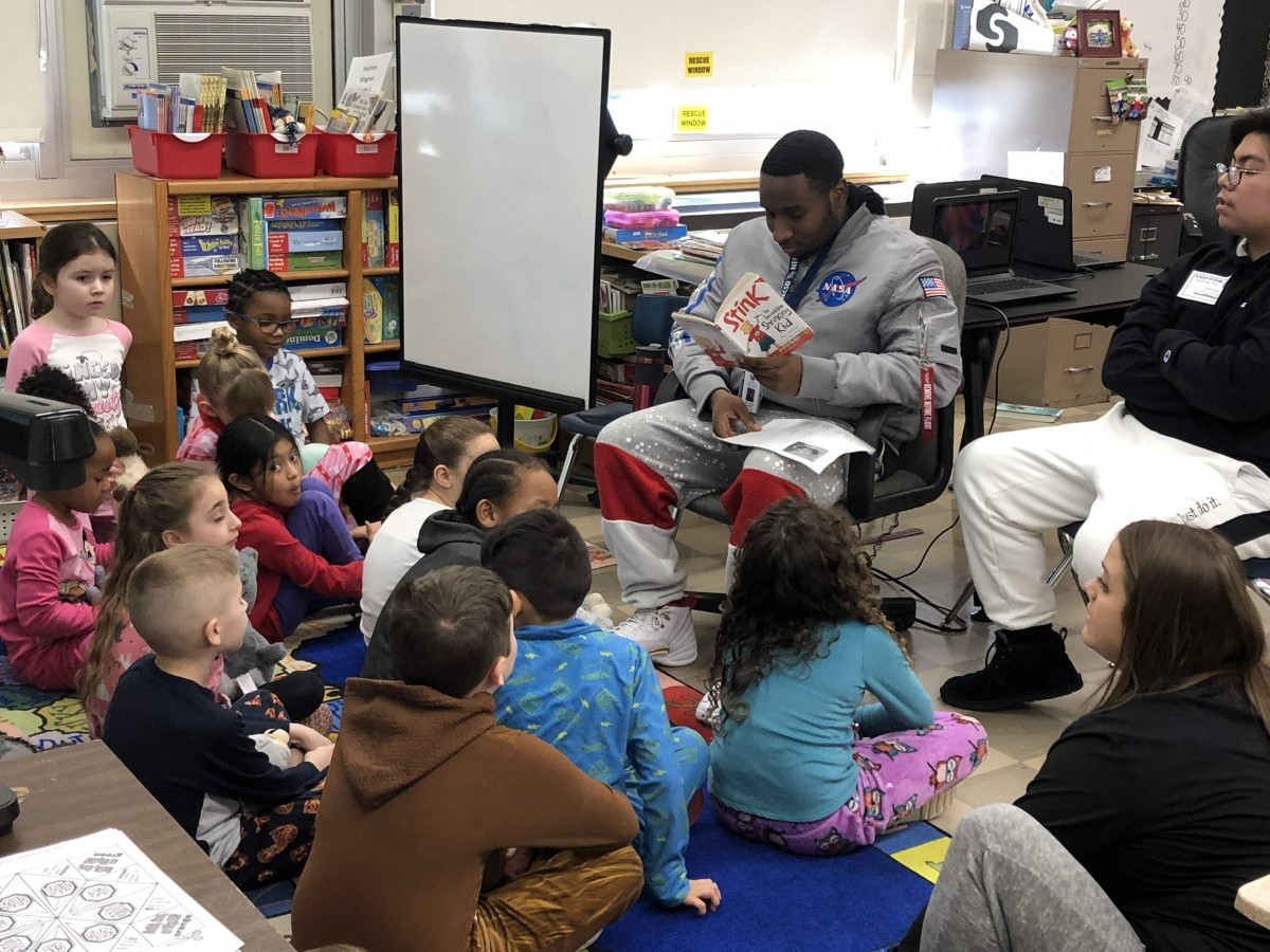 NFA West scholar reading to Meadow Hill scholars.