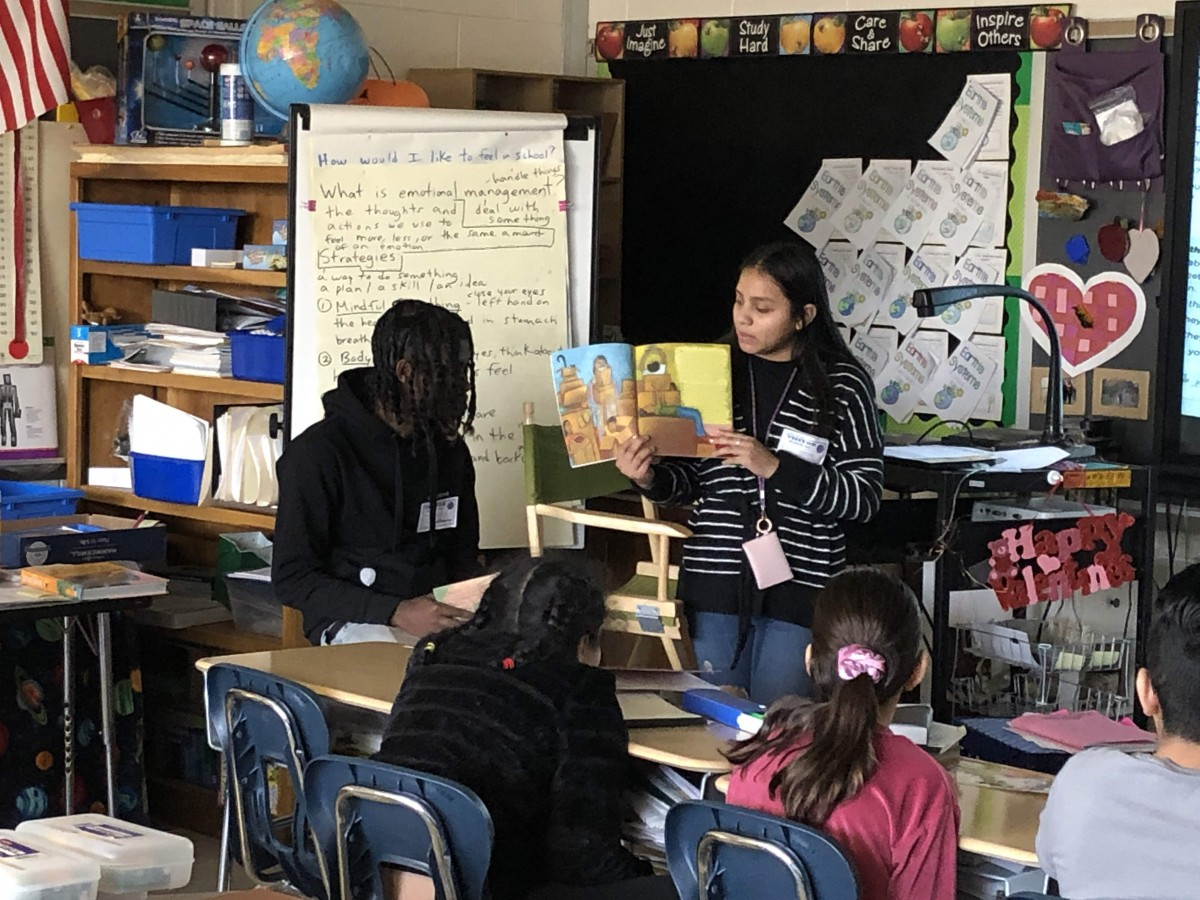 NFA West scholars reading to Meadow Hill scholars.