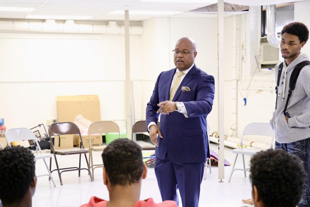 Board member, Mr. Howard speaks to  NFA West's Young Men's Group Mentoring Program