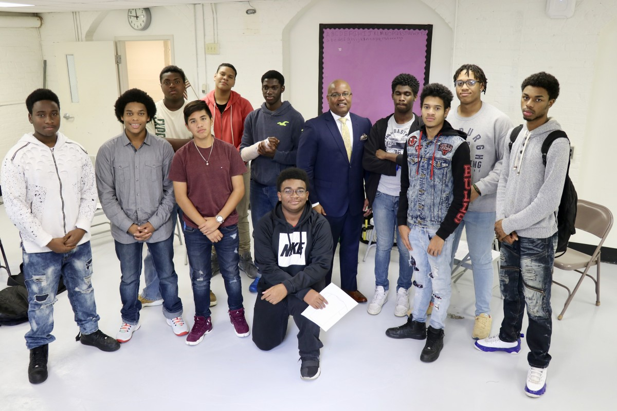 Members of NFA West's Young Men's Group Mentoring Program stand with Mr. Howard