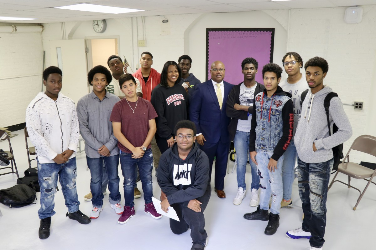 Members of NFA West's Young Men's Group Mentoring Program stand with Mr. Howard and School Counselor, Ms. Stukes