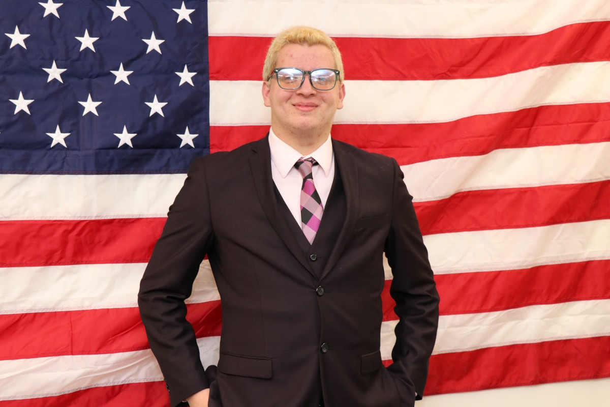 Student poses for photo after winning mock election.
