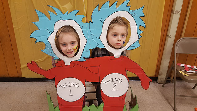 Students in the Thing 1 and Thing 2 cutout.