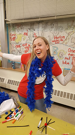 A teacher enjoying Dr. Suess Night