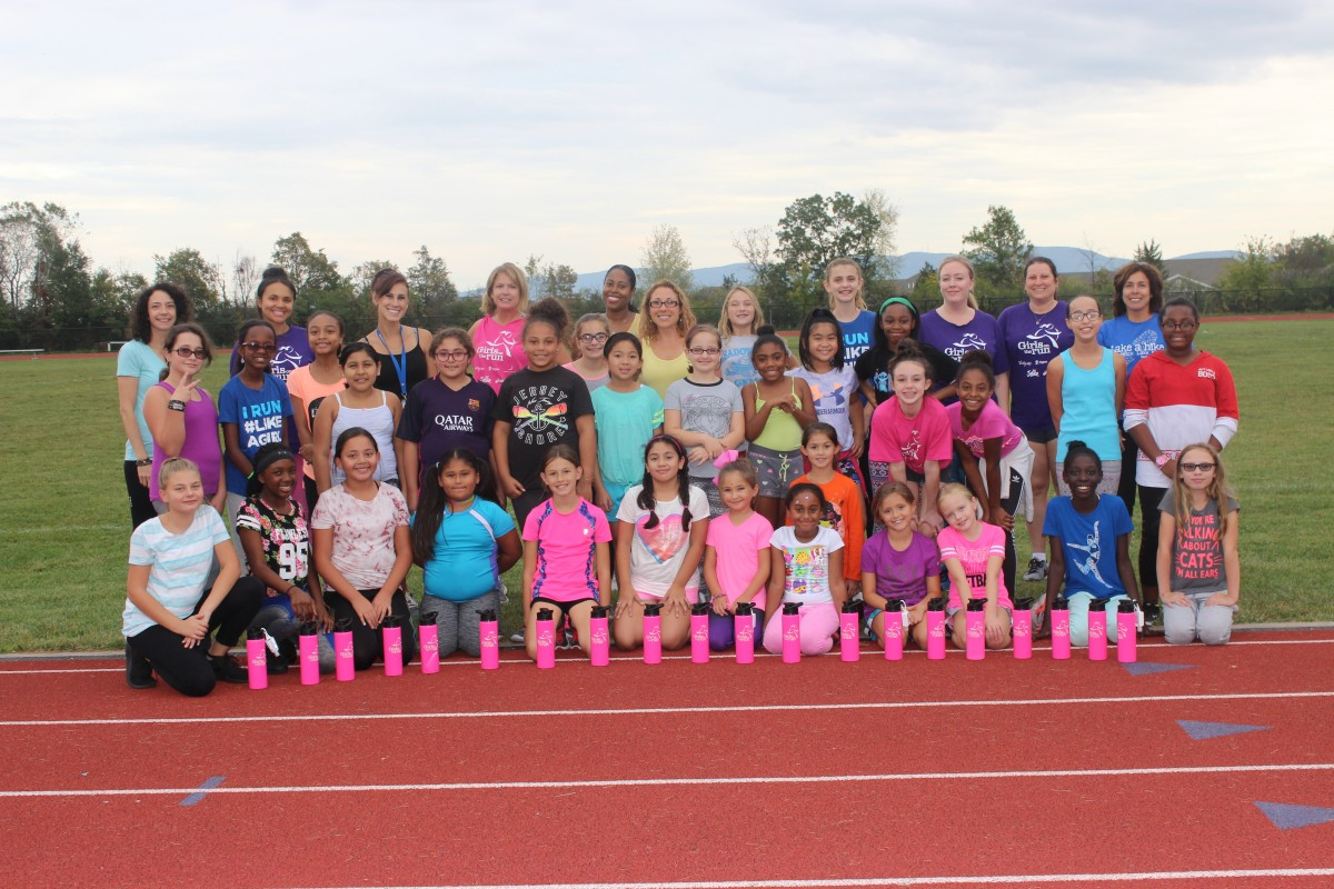 Group photo of girls on the track.